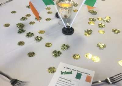 Table decorations, including medallions and Irish flags, at the Ireland-themed dinner